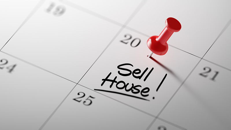 Sell House written on a calendar